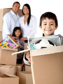 Boy moving house — Stock Photo