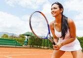 Kvinna som spelar tennis — Stockfoto