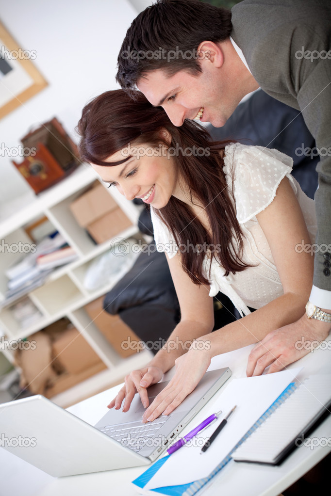 Business couple working at the office looking happy — Stock Photo #8850431