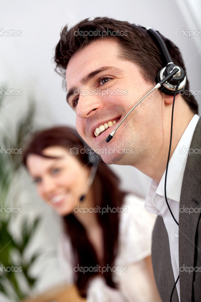 Business support consultants with headphones during a telephone conversation — Stock Photo #8850434