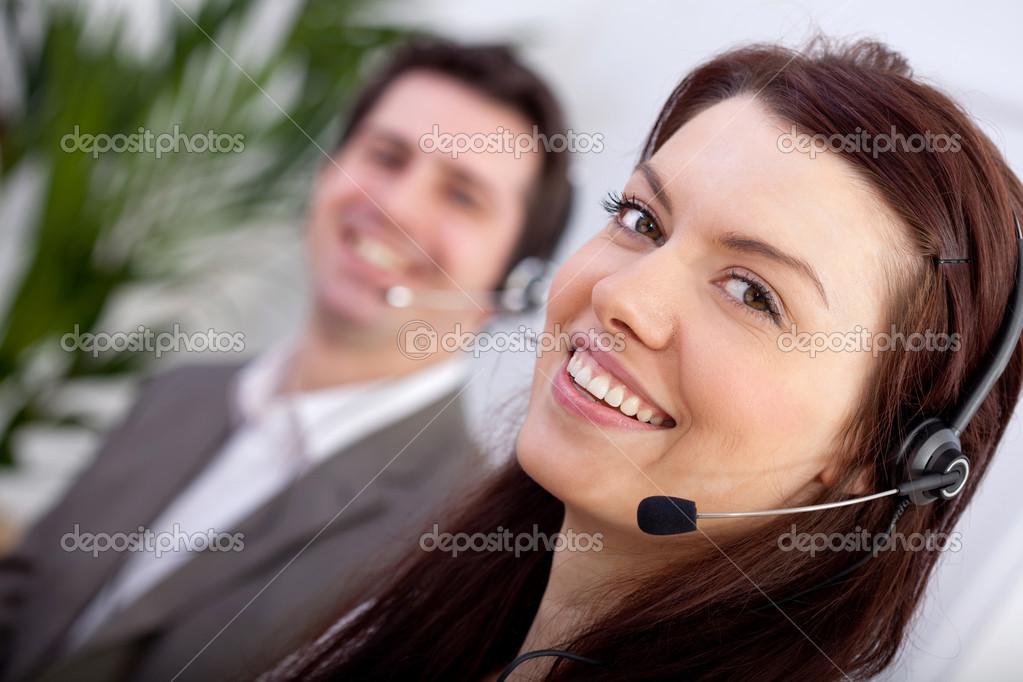 Woman with a headset in a call center  Stock Photo #8850438