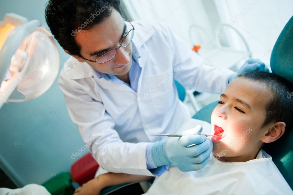 Young boy visiting the dentist for a check up — Photo #8851631