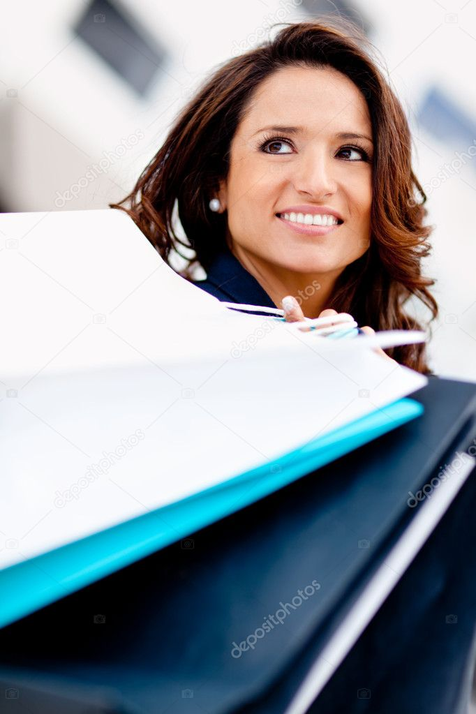 Happy female shopper smiling and carrying bags — Stock Photo #8851718