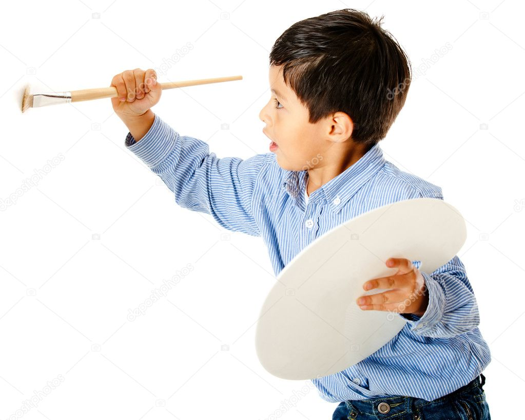 Boy holding a brush and painting on the wall — Stock Photo #8851767