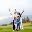 Happy family playing golf — Stock Photo