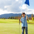 Royalty-Free Stock Photo: Boy with a golf flag
