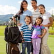 Family at a golf field — Stock Photo #8901764