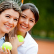 Women playing tennis — Stock Photo