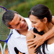 Foto Stock: Tennis couple flirting