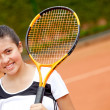 Female teenager playing tennis — Stock Photo