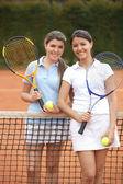 Women playing tennis — Stock Photo