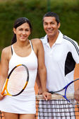 Woman with tennis trainer — Stock Photo