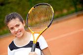Weibliche teenager tennis spielen — Stockfoto