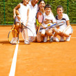Stock Photo: Family at the tennis court