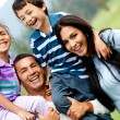 Happy family outdoors — Stock Photo #8927477