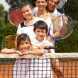 Stock Photo: Family at tennis court