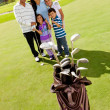 Family at a golf field — Stock Photo