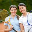 Women playing tennis - Foto Stock