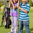 Kids at a golf field - Stock Photo