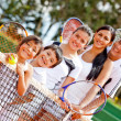 Stock Photo: Tennis family by the net