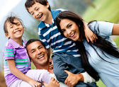Happy family outdoors — Foto Stock