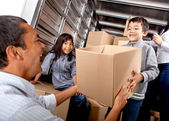 Family loading a truck — Stock Photo