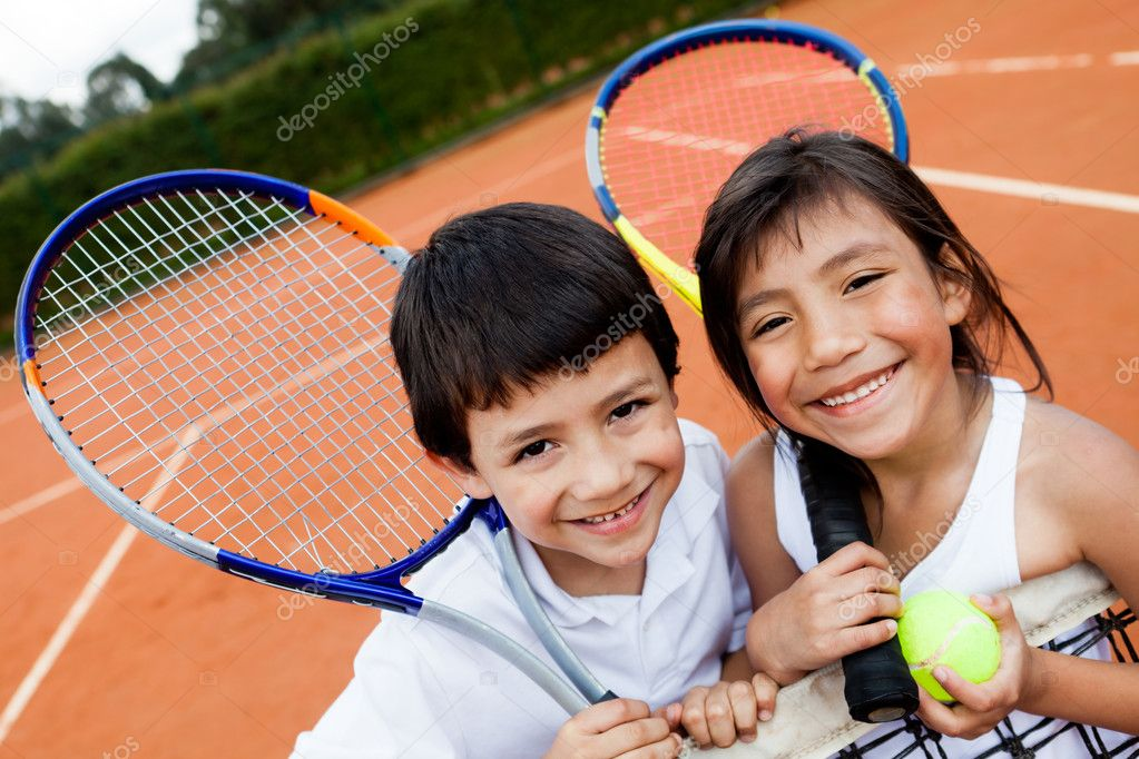 Portrait of young tennis players smiling at the court — Stock Photo #8927418