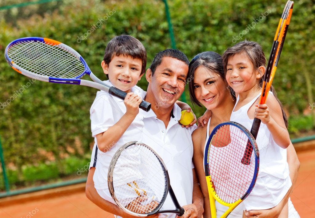 Happy family portrait playing tennis outdoors and smiling — Stock Photo #8927842