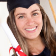 Beautiful female graduate — Stock Photo