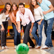 Group of friends bowling — Stock Photo