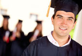 Happy male graduate — Stock Photo
