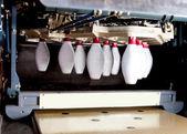 Machine placing bowling pins — Stock Photo