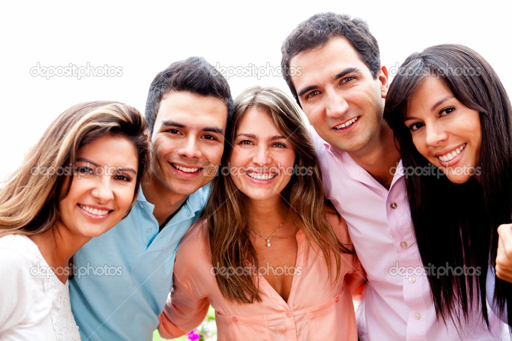 Group of close friends smiling outdoors and hugging — Stock Photo #8954016