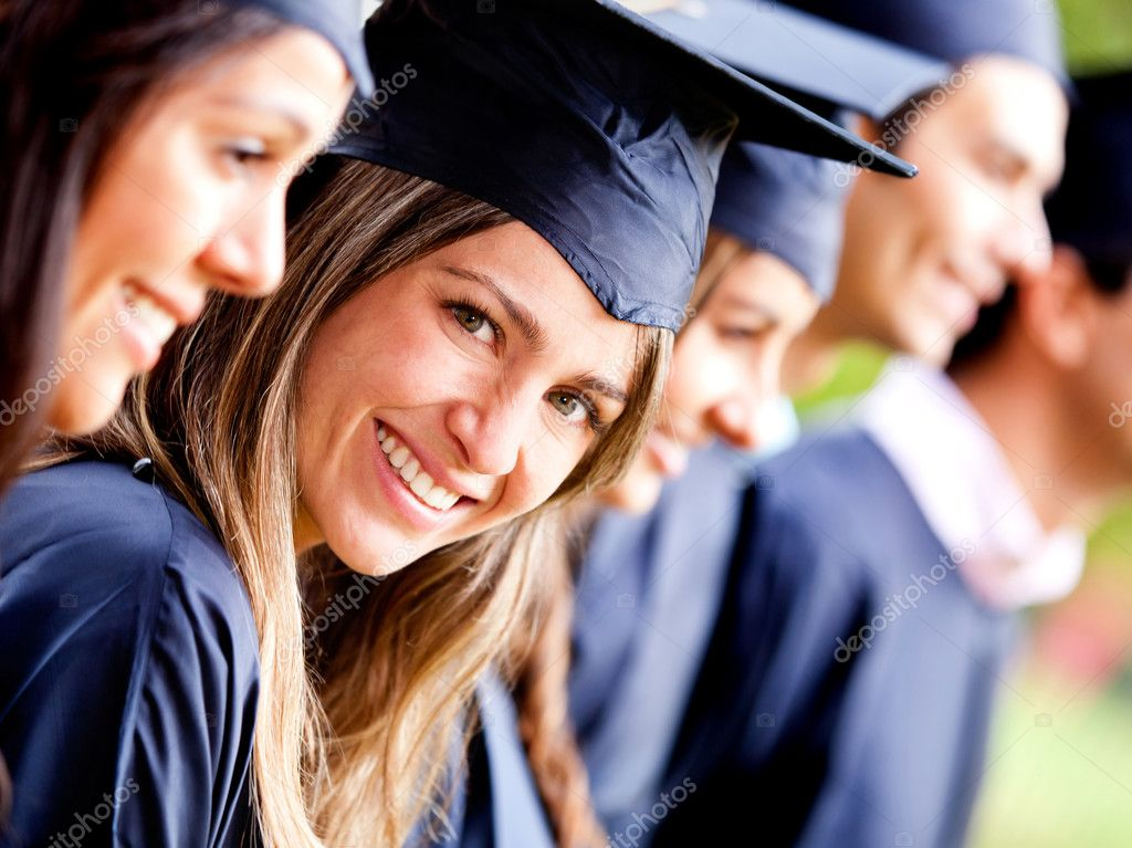 Woman standing out from a graduation group smiling — Stock Photo #8954018