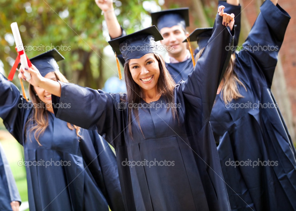 Happy group of students with arms up at their graduation  Stock Photo #8954021