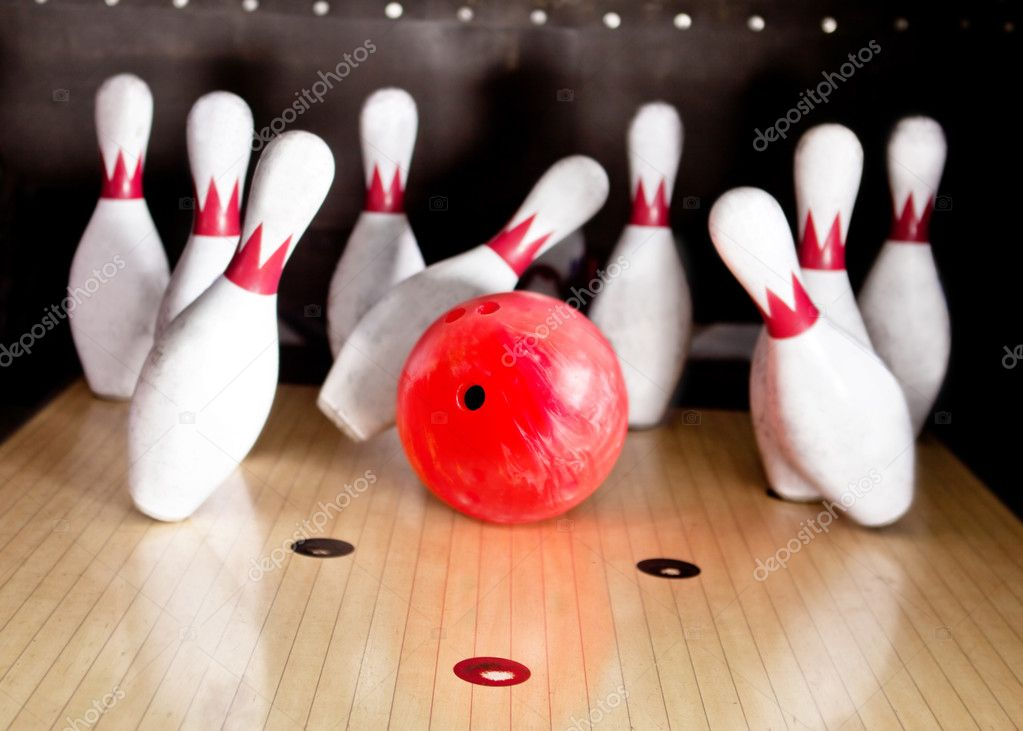 Bowling strike - ball hitting pins in the alley — Stock Photo #8954071