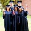 Group of friends at graduation — Stock Photo