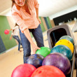 Woman bowling - Stock Photo