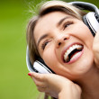 Happy woman with headphones - Stock Photo