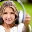 Woman holding headphones - Stock Photo