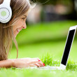 Girl downloading music — Stock Photo #9024453