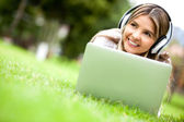 Woman downloading music — Stock Photo