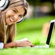 Happy woman downloading music — Stock Photo #9042918