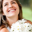 Woman with a bunch of flowers — Stockfoto
