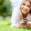 Woman with her mobile phone — Stock Photo #9043028