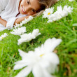 Woman lying on a floral garden — Stock Photo