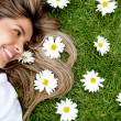 Woman in a garden of flowers — Stock Photo #9043070