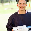 Male graduate with books — Stock Photo