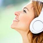 Woman with headphones — Stock Photo