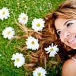 Woman lying on a flower garden - Stock Photo